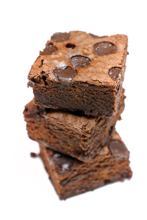 Chocolate brownie stacked isolated on white background Imagens