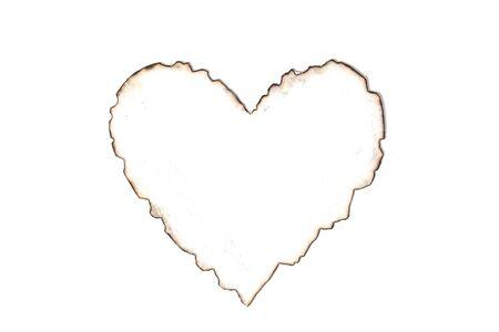 Burned heart shape white paper
