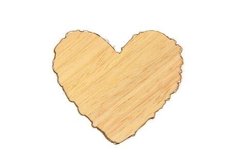 Burned heart shape white paper on wooden table