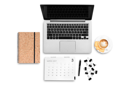 Top view work space computer notebook coffee latte calendar and paper clip flat layout white background Imagens