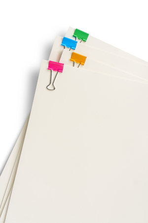 Colorful clip on blank paper documents white background isolated