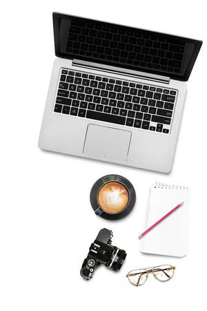 Reporter workspace with computer notebook vintage camera coffee notepad and pencil on white background