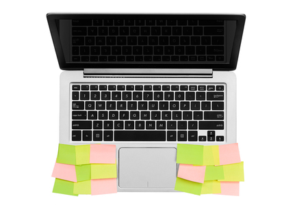Gray silver computer notebook with postit paper isolated on white background