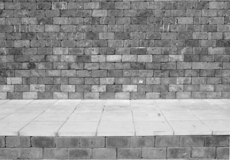 gray stone brick wall and pavement grunge background