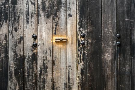 Rustic black wooden door background