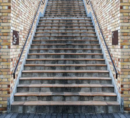 Grunge orange cement staircase brick wall Imagens - 100354822