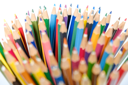 Sharp color pencil close up on white background copy space