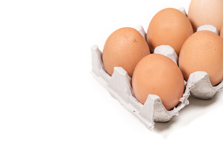 Fresh chicken eggs on paper box pack isolated on white background Imagens - 110962574
