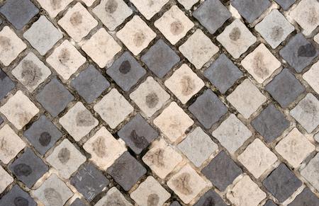 slantingly pattern wet old grunge stone brick foot path pavement background texture Imagens