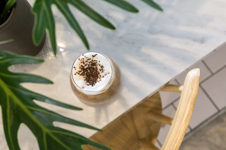 top view coffee latte on white marble table interior in a cafe