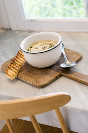 Creamy mushroom soup on marble table in a restaurant