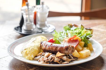 Big breakfast italian sausage scrambled eggs mushrooms sauteed bacon and dice potato