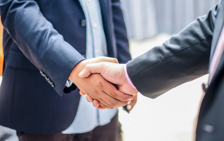 close up business man handshake together on blur meeting room background in :agreement,accept,approve financial cooperative concept.improvedevelopment.trust,goal,team,hand,shake:international invest Stock Photo