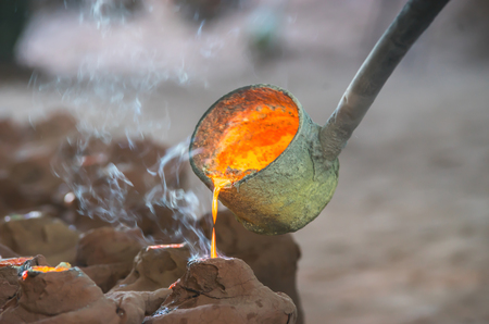 crucible: gold pour Stock Photo