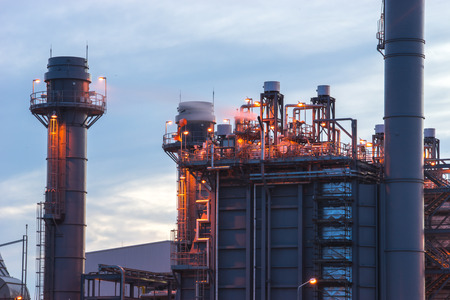 combined: Gas turbine electrical power plant at dusk Stock Photo