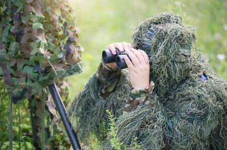 ornithologist: binoculars in the hand of ornithologist Stock Photo