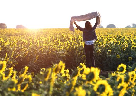 Teenage girl enjoy with sunshine in wheat field Stock Photo