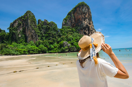 Happy woman on vacation in Thailand.