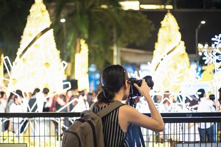 Professional female photographer holding a camera Stock Photo