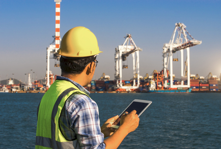 Businessman use tablet at port import and export shipping
