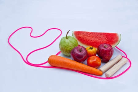 Jump Rope with fruit on white background. photo