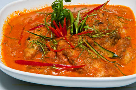 Thai food, fish in red curry. photo