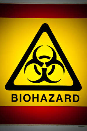 infectious waste: Biohazard symbol in black on a yellow warning triangle. Stock Photo