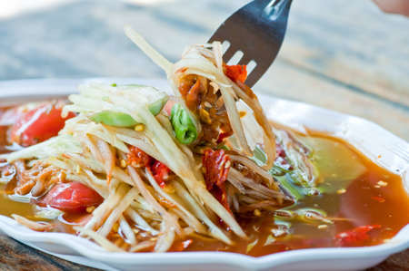 A photo of delicious thai food.( papaya salad)