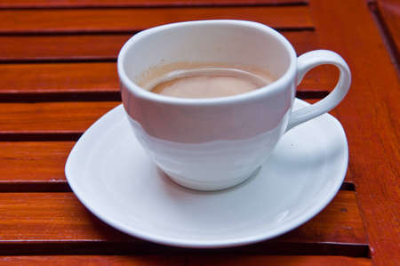 Fresh coffee with milk in cup.