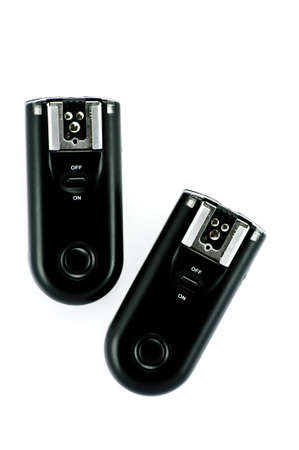 Wireless trigger (receiver and transmitter) on the white background.