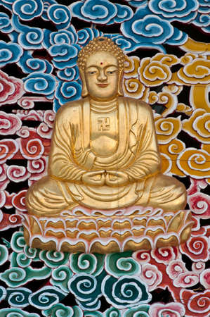 buddha face: Giant Buddha sitting on lotus.