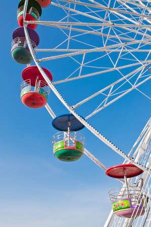 Colorful ferris wheel and blue sky. photo