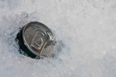 Beverage cans in the ice. photo