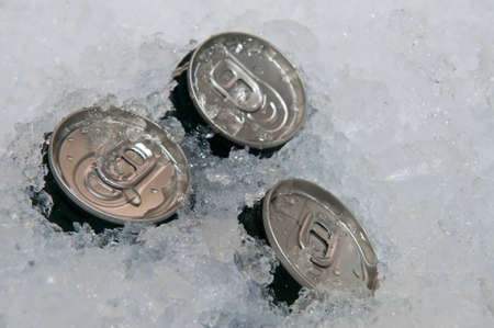 Beverage cans in the ice. Stock Photo