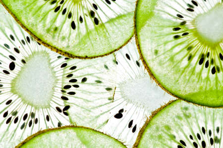 Sliced kiwi  in water isolated on a white background. photo