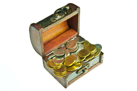 Old style wooden box full with gold money isolated on white background. photo