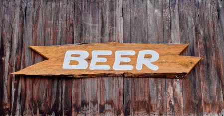 Wooden pub sign of beer