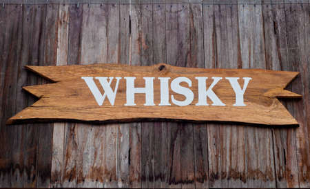Wooden pub sign of whisky photo