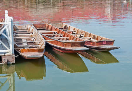 Rowing boats moored in the harbor.