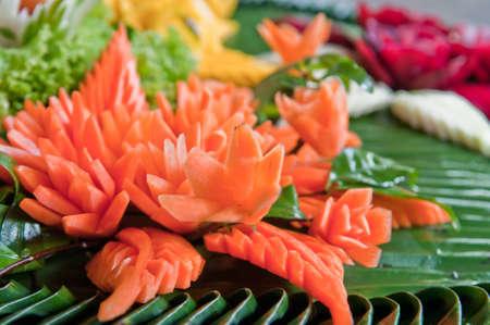Thai art of carved fruit like a flower Stock Photo