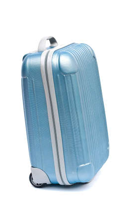 blue plastic suitcase on wheels isolated on white photo