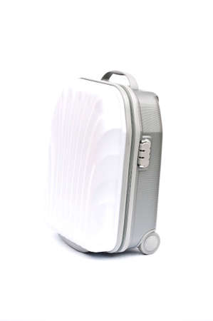 white plastic suitcase on wheels isolated on white photo