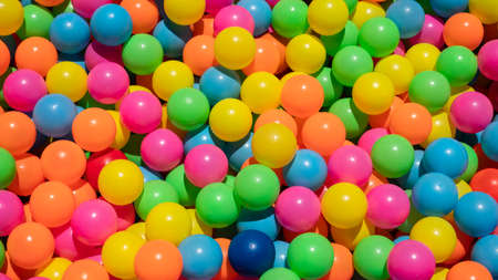 Cleaning of multicolored plastic balls by washing the water and exposing to the sun 版權商用圖片