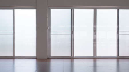 Front view of frosted glass sliding doors with screen doors and light reflection on tile floor surface in empty room Stock fotó