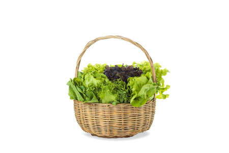 Various fresh salad vegetables in bamboo basket on isolated white background 免版税图像