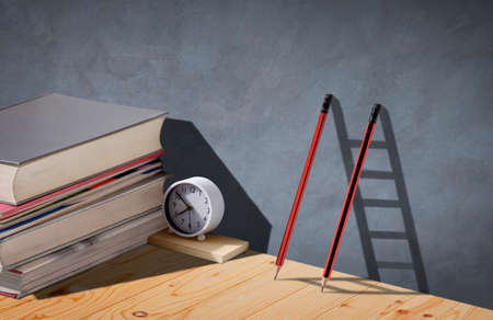 Two pencils and shadow in form of ladder with stack of textbooks and white clock on wooden table, Concept of Education and Learning is the ladder to successful Foto de archivo