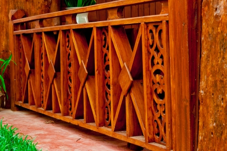 Fence made of teak wood carving  photo