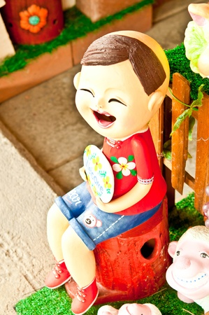 girl clay doll in garden photo