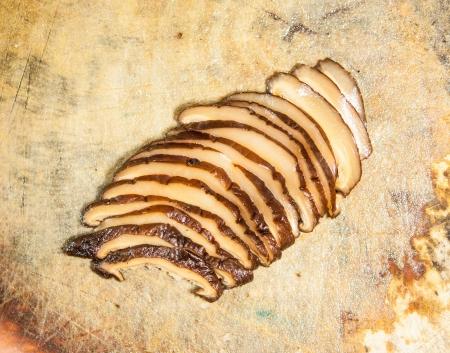 Sliced Shiitake on wood photo