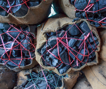 gunny: black charcoal in gunny  for sale Stock Photo